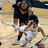 "University of Colorado's Arielle Roberson is fouled by Adrianne Thomas during a game against Arizona State University on Friday, Jan. 18, at the Coors Event Center on the CU campus in Boulder. For more photos of the game go to  <a href=""http://www.dailycamera.com"">http://www.dailycamera.com</a><br /> Jeremy Papasso/ Camera"