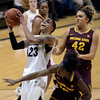 "University of Colorado's Chucky Jeffery goes for a shot over Promise Amukamara, front, and Haley Videckis, No. 42, during a game against Arizona State University on Friday, Jan. 18, at the Coors Event Center on the CU campus in Boulder. For more photos of the game go to  <a href=""http://www.dailycamera.com"">http://www.dailycamera.com</a><br /> Jeremy Papasso/ Camera"
