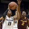 "University of Colorado's Brittany Wilson takes a shot over Micaela Pickens during a game against Arizona State University on Friday, Jan. 18, at the Coors Event Center on the CU campus in Boulder. For more photos of the game go to  <a href=""http://www.dailycamera.com"">http://www.dailycamera.com</a><br /> Jeremy Papasso/ Camera"