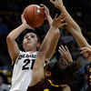 "University of Colorado's Jasmine Sborov takes a shot over Adrianne Thomas during a game against Arizona State University on Friday, Jan. 18, at the Coors Event Center on the CU campus in Boulder. For more photos of the game go to  <a href=""http://www.dailycamera.com"">http://www.dailycamera.com</a><br /> Jeremy Papasso/ Camera"