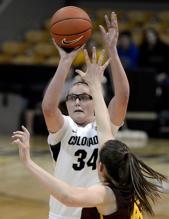 "University of Colorado's Jen Reese takes a shot over Eliza Normen during a game against Arizona State University on Friday, Jan. 18, at the Coors Event Center on the CU campus in Boulder. For more photos of the game go to  <a href=""http://www.dailycamera.com"">http://www.dailycamera.com</a><br /> Jeremy Papasso/ Camera"