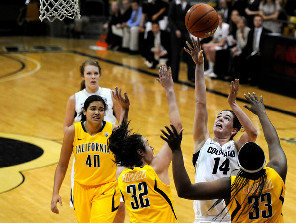 "University of Colorado's Meagan Malcolm-Peck takes a shot over University of California defenders Talia Caldwell, No. 33, Lindsay Sherbert, No. 32, and Justine Hartman, No. 40, during a basketball game on Thursday, Jan. 12, at the Coors Event Center on the CU campus in Boulder. For more photos of the game go to  <a href=""http://www.dailycamera.com"">http://www.dailycamera.com</a><br /> Jeremy Papasso/ Camera"