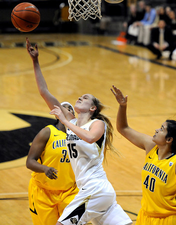 "University of Colorado's Julie Seabrook goes for a lay-up over the University of California's Justine Hartman, No. 40, and Talia Caldwell, back, during a basketball game on Thursday, Jan. 12, at the Coors Event Center on the CU campus in Boulder. For more photos of the game go to  <a href=""http://www.dailycamera.com"">http://www.dailycamera.com</a><br /> Jeremy Papasso/ Camera"