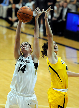 "University of Colorado's Meagan Malcolm-Peck fights for a rebound with the University of California's Lindsay Sherbert during a basketball game on Thursday, Jan. 12, at the Coors Event Center on the CU campus in Boulder. For more photos of the game go to  <a href=""http://www.dailycamera.com"">http://www.dailycamera.com</a><br /> Jeremy Papasso/ Camera"