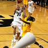 "University of Colorado's Chucky Jeffery goes for a shot over the University of California's Eliza Pierre during a basketball game on Thursday, Jan. 12, at the Coors Event Center on the CU campus in Boulder. For more photos of the game go to  <a href=""http://www.dailycamera.com"">http://www.dailycamera.com</a><br /> Jeremy Papasso/ Camera"
