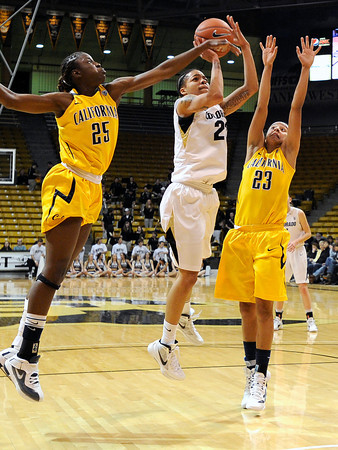 """University of Colorado's Chucky Jeffery takes a shot under pressure from the University of California's Gennifer Brandon, No. 25, and Layshia Clarendon during a basketball game on Thursday, Jan. 12, at the Coors Event Center on the CU campus in Boulder. California won the game 68-55. For more photos of the game go to  <a href=""""http://www.dailycamera.com"""">http://www.dailycamera.com</a><br /> Jeremy Papasso/ Camera"""