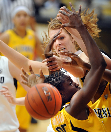 """Rachel Hargis, top,  of CU  fights for a rebound with Gennifer Brandon of Cal during the second half of the January 12, 2012 game in Boulder.<br /> For more photos of the game, go to  <a href=""""http://www.dailycamera.com"""">http://www.dailycamera.com</a>.<br /> January 12, 2012 / Cliff Grassmick"""