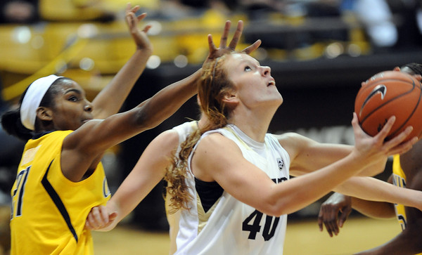 "Rachel Hargis of CU uses the rim to block Reshanda Gray of Cal<br /> during the first half of the January 12, 2012 game in Boulder.<br /> For more photos of the game, go to  <a href=""http://www.dailycamera.com"">http://www.dailycamera.com</a>.<br /> January 12, 2012 / Cliff Grassmick"
