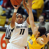 "Brittany Wilson of CU shoots over Mikayla Lyles of Cal<br /> during the second half of the January 12, 2012 game in Boulder.<br /> For more photos of the game, go to  <a href=""http://www.dailycamera.com"">http://www.dailycamera.com</a>.<br /> January 12, 2012 / Cliff Grassmick"