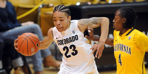 "Chucky Jeffery  of Colorado drives around Eliza Pierre of California<br /> during the first half of the January 12, 2012 game in Boulder.<br /> For more photos of the game, go to  <a href=""http://www.dailycamera.com"">http://www.dailycamera.com</a>.<br /> January 12, 2012 / Cliff Grassmick"