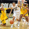 "Chucky Jeffery, center,   of Colorado, runs past Brittany Boyd, left, and Talia Caldwell of California during the first half of the January 12, 2012 game in Boulder.<br /> For more photos of the game, go to  <a href=""http://www.dailycamera.com"">http://www.dailycamera.com</a>.<br /> January 12, 2012 / Cliff Grassmick"
