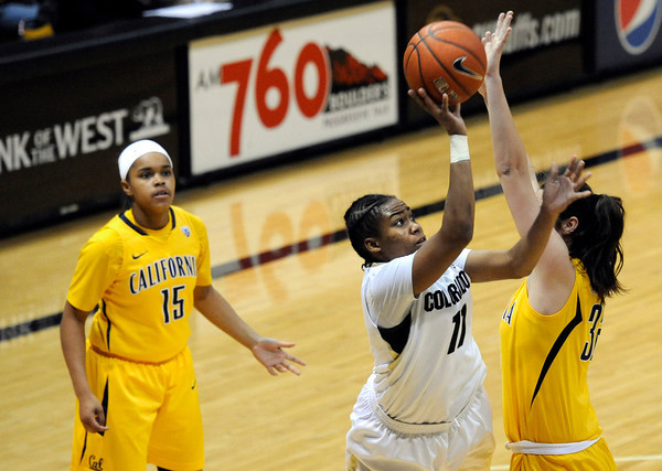 "University of Colorado's Brittany Wilson takes a shot over the University of California's Lindsay Sherbert, right, during a basketball game on Thursday, Jan. 12, at the Coors Event Center on the CU campus in Boulder. For more photos of the game go to  <a href=""http://www.dailycamera.com"">http://www.dailycamera.com</a><br /> Jeremy Papasso/ Camera"