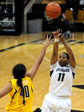 """University of Colorado's Brittany Wilson takes a shot over the University of California's Justine Hartman during a basketball game on Thursday, Jan. 12, at the Coors Event Center on the CU campus in Boulder. For more photos of the game go to  <a href=""""http://www.dailycamera.com"""">http://www.dailycamera.com</a><br /> Jeremy Papasso/ Camera"""