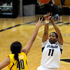 "University of Colorado's Brittany Wilson takes a shot over the University of California's Justine Hartman during a basketball game on Thursday, Jan. 12, at the Coors Event Center on the CU campus in Boulder. For more photos of the game go to  <a href=""http://www.dailycamera.com"">http://www.dailycamera.com</a><br /> Jeremy Papasso/ Camera"