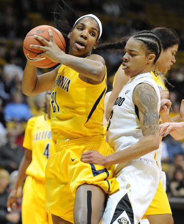 "Reshanda Gray of Cal gets a rebound in front of Chucky Jeffery of CU<br /> during the first half of the January 12, 2012 game in Boulder.<br /> For more photos of the game, go to  <a href=""http://www.dailycamera.com"">http://www.dailycamera.com</a>.<br /> January 12, 2012 / Cliff Grassmick"