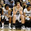 "University of Colorado's Esther Lee, left, Ashley Wilson, Rachel Hargis, and Brittany Wilson show their disappointment in the final seconds of the game against the University of California on Thursday, Jan. 12, at the Coors Event Center on the CU campus in Boulder. California won the game 68-55. For more photos of the game go to  <a href=""http://www.dailycamera.com"">http://www.dailycamera.com</a><br /> Jeremy Papasso/ Camera"