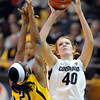 "Rachel Hargis of CU shoots over Reshanda Gray of Cal<br /> during the second half of the January 12, 2012 game in Boulder.<br /> For more photos of the game, go to  <a href=""http://www.dailycamera.com"">http://www.dailycamera.com</a>.<br /> January 12, 2012 / Cliff Grassmick"