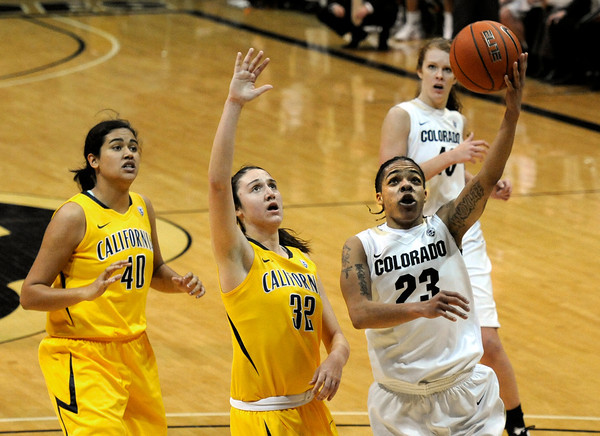 """University of Colorado's Chucky Jeffery goes for a lay-up over the University of California's Lindsay Sherbert, No. 32, during a basketball game on Thursday, Jan. 12, at the Coors Event Center on the CU campus in Boulder. For more photos of the game go to  <a href=""""http://www.dailycamera.com"""">http://www.dailycamera.com</a><br /> Jeremy Papasso/ Camera"""