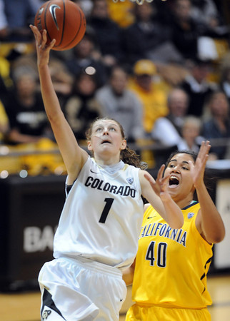 "Lexy Kresl of Colorado scores past Justine Hartman of California<br /> during the first half of the January 12, 2012 game in Boulder.<br /> For more photos of the game, go to  <a href=""http://www.dailycamera.com"">http://www.dailycamera.com</a>.<br /> January 12, 2012 / Cliff Grassmick"