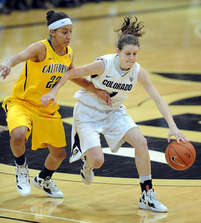 """Lexy Kresl of CU drives around Layshia Clarendon of Cal<br /> during the first half of the January 12, 2012 game in Boulder.<br /> For more photos of the game, go to  <a href=""""http://www.dailycamera.com"""">http://www.dailycamera.com</a>.<br /> January 12, 2012 / Cliff Grassmick"""
