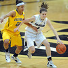 "Lexy Kresl of CU drives around Layshia Clarendon of Cal<br /> during the first half of the January 12, 2012 game in Boulder.<br /> For more photos of the game, go to  <a href=""http://www.dailycamera.com"">http://www.dailycamera.com</a>.<br /> January 12, 2012 / Cliff Grassmick"
