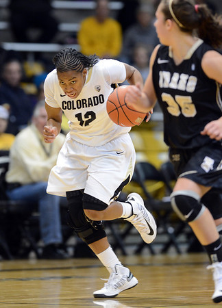 """Ashley Wilson of CU takes off on a fastbreak during the first half of the November 11,  2012 game in Boulder.<br /> For more photos of the CU women, go to  <a href=""""http://www.dailycamera.com"""">http://www.dailycamera.com</a><br /> Cliff Grassmick / November 11, 2012"""