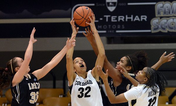 "Arielle Roberson (32) gets the rebound from Connie Ballestero, left, and Ali Forde, both of Idaho, during the first half of the November 11,  2012 game in Boulder.<br /> For more photos of the CU women, go to  <a href=""http://www.dailycamera.com"">http://www.dailycamera.com</a><br /> Cliff Grassmick / November 11, 2012"