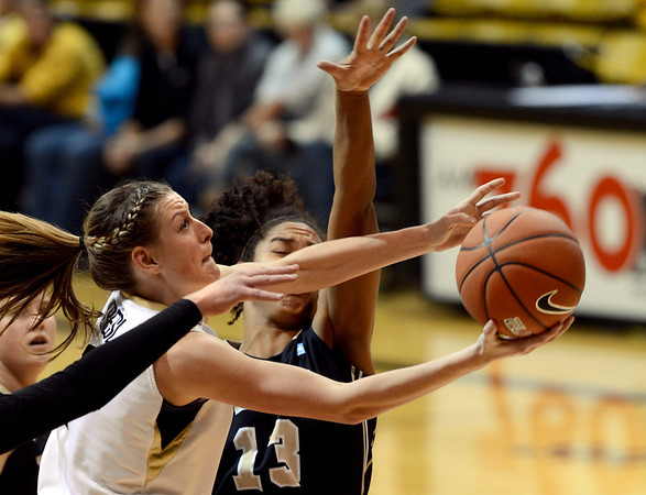 """Lexy Kresl of Colorado goes under the block attempt of Ali Forde of Idaho during the second half of the November 11,  2012 game in Boulder.<br /> For more photos of the CU women, go to  <a href=""""http://www.dailycamera.com"""">http://www.dailycamera.com</a><br /> Cliff Grassmick / November 11, 2012"""