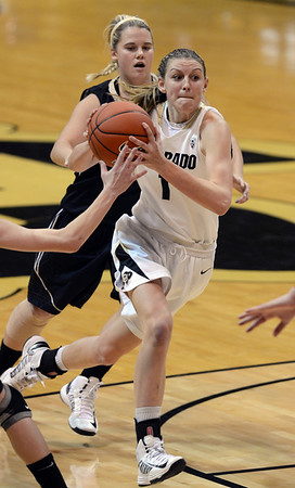 "Lexy Kresl of CU drives past Satcy Barr of Idaho during the second half of the November 11,  2012 game in Boulder.<br /> For more photos of the CU women, go to  <a href=""http://www.dailycamera.com"">http://www.dailycamera.com</a><br /> Cliff Grassmick / November 11, 2012"