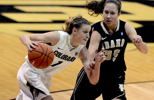 "Lexy Kresl of CU drives on Connie Ballesteros of Idaho during the second half of the November 11,  2012 game in Boulder.<br /> For more photos of the CU women, go to  <a href=""http://www.dailycamera.com"">http://www.dailycamera.com</a><br /> Cliff Grassmick / November 11, 2012"