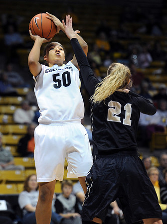 "Jamee Swan of CU shoots over Jessica Graham of Idaho during the first half of the November 11,  2012 game in Boulder.<br /> For more photos of the CU women, go to  <a href=""http://www.dailycamera.com"">http://www.dailycamera.com</a><br /> Cliff Grassmick / November 11, 2012"