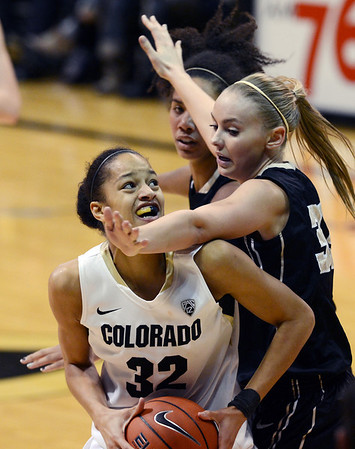 "Arielle Roberson of CU tries to find room on Alyssa Charlston of Idaho during the second half of the November 11,  2012 game in Boulder.<br /> For more photos of the CU women, go to  <a href=""http://www.dailycamera.com"">http://www.dailycamera.com</a><br /> Cliff Grassmick / November 11, 2012"
