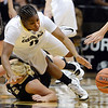 "Brittany Wilson, top, of Colorado tries to get a steal from Stacy Barr of Idaho during the first half of the November 11,  2012 game in Boulder.<br /> For more photos of the CU women, go to  <a href=""http://www.dailycamera.com"">http://www.dailycamera.com</a><br /> Cliff Grassmick / November 11, 2012"