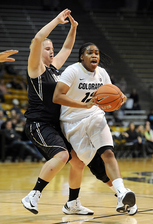 "Ashley Wilson drives on Stacy Barr of Idaho during the first half of the November 11,  2012 game in Boulder.<br /> For more photos of the CU women, go to  <a href=""http://www.dailycamera.com"">http://www.dailycamera.com</a><br /> Cliff Grassmick / November 11, 2012"