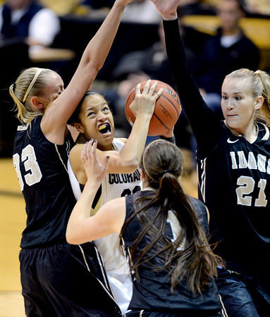 "Arielle Roberson of Colorado is trapped by Alyssa Charlston, left, Christina Salvatore (1) and Jessica Graham of Idaho during the second half of the November 11,  2012 game in Boulder.<br /> For more photos of the CU women, go to  <a href=""http://www.dailycamera.com"">http://www.dailycamera.com</a><br /> Cliff Grassmick / November 11, 2012"