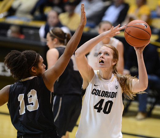 "Rachel Hargis of CU shoots over Ali Forde of Idaho during the second half of the November 11,  2012 game in Boulder.<br /> For more photos of the CU women, go to  <a href=""http://www.dailycamera.com"">http://www.dailycamera.com</a><br /> Cliff Grassmick / November 11, 2012"
