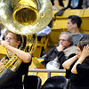 "Lisa Leftakes, of Boulder, right, covers her ears as University of Colorado Buff Basketball Band member Kyle Proctor plays the ""Super Duper Tuba Cheer"" during the first round of the 2012 Women's NIT tournament against Northern Colorado on Wednesday, March 14, at the Coors Event Center on the CU campus in Boulder. CU won the game 54-40. For more photos and video of the game go to  <a href=""http://www.dailycamera.com"">http://www.dailycamera.com</a><br /> Jeremy Papasso/ Camera"