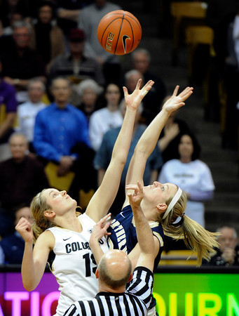 "University of Colorado's Julie Seabrook, left, goes against Northern Colorado's Kim Lockridge in the tip-off to start the first round of the 2012 Women's NIT tournament on Wednesday, March 14, at the Coors Event Center on the CU campus in Boulder. CU won the game 54-40. For more photos and video of the game go to  <a href=""http://www.dailycamera.com"">http://www.dailycamera.com</a><br /> Jeremy Papasso/ Camera"