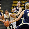 "University of Colorado's Ashley Wilson fights to keep possession of the ball from Northern Colorado's Amy Marin, left, Kaisha Brown, center, and Lauren Oosdkye during the first round of the 2012 Women's NIT tournament on Wednesday, March 14, at the Coors Event Center on the CU campus in Boulder. CU won the game 54-40. For more photos and video of the game go to  <a href=""http://www.dailycamera.com"">http://www.dailycamera.com</a><br /> Jeremy Papasso/ Camera"