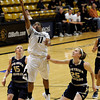 "University of Colorado's Brittany Wilson takes a shot over Northern Colorado's Victoria Timm, No. 15, and Milly Duehn, No. 25, during the first round of the 2012 Women's NIT tournament on Wednesday, March 14, at the Coors Event Center on the CU campus in Boulder. For more photos and video of the game go to  <a href=""http://www.dailycamera.com"">http://www.dailycamera.com</a><br /> Jeremy Papasso/ Camera"