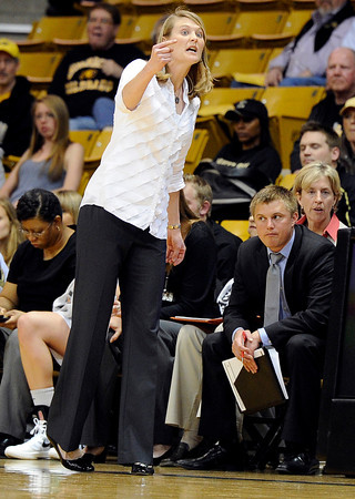 "University of Colorado Head Coach Linda Lappe yells out a defensive strategy to her players while playing Northern Colorado during the first round of the 2012 Women's NIT tournament on Wednesday, March 14, at the Coors Event Center on the CU campus in Boulder. For more photos and video of the game go to  <a href=""http://www.dailycamera.com"">http://www.dailycamera.com</a><br /> Jeremy Papasso/ Camera"