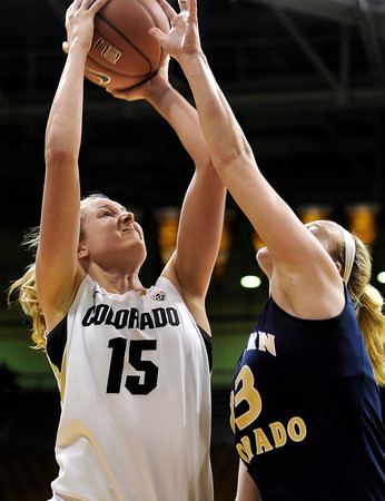 "University of Colorado's Julie Seabrook takes a shot over over Northern Colorado's Kim Lockridge during the first round of the 2012 Women's NIT tournament on Wednesday, March 14, at the Coors Event Center on the CU campus in Boulder. CU won the game 54-40. For more photos and video of the game go to  <a href=""http://www.dailycamera.com"">http://www.dailycamera.com</a><br /> Jeremy Papasso/ Camera"