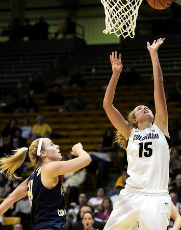"University of Colorado's Julie Seabrook takes a shot over Northern Colorado's Lauren Oosdkye during the first round of the 2012 Women's NIT tournament on Wednesday, March 14, at the Coors Event Center on the CU campus in Boulder. For more photos and video of the game go to  <a href=""http://www.dailycamera.com"">http://www.dailycamera.com</a><br /> Jeremy Papasso/ Camera"