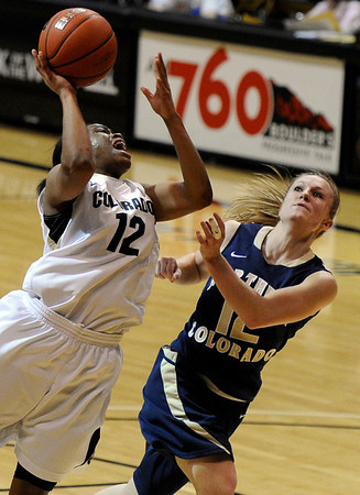 """University of Colorado's Ashley Wilson takes a shot over Northern Colorado's Amy Marin during the first round of the 2012 Women's NIT tournament on Wednesday, March 14, at the Coors Event Center on the CU campus in Boulder. CU won the game 54-40. For more photos and video of the game go to  <a href=""""http://www.dailycamera.com"""">http://www.dailycamera.com</a><br /> Jeremy Papasso/ Camera"""
