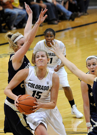 "University of Colorado's Julie Seabrook drives to the hoop past Northern Colorado's Kim Lockridge, left, and a swarm of other defenders during the first round of the 2012 Women's NIT tournament on Wednesday, March 14, at the Coors Event Center on the CU campus in Boulder. For more photos and video of the game go to  <a href=""http://www.dailycamera.com"">http://www.dailycamera.com</a><br /> Jeremy Papasso/ Camera"