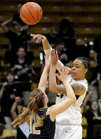 "University of Colorado's Chucky Jeffery passes to a teammate over Northern Colorado's Amy Marin during the first round of the 2012 Women's NIT tournament on Wednesday, March 14, at the Coors Event Center on the CU campus in Boulder. CU won the game 54-40. For more photos and video of the game go to  <a href=""http://www.dailycamera.com"">http://www.dailycamera.com</a><br /> Jeremy Papasso/ Camera"