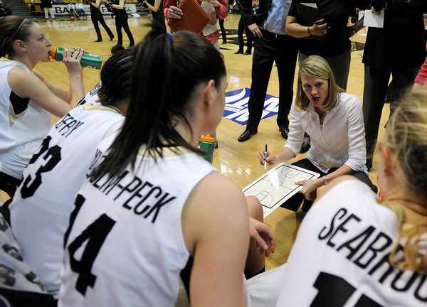 """University of Colorado's Julie Seabrook, right, Meagan Malcolm-Peck, center, Chucky Jeffery and Lexy Kresl, left, listen as Head Coach Linda Lappe goes over a game plan during a time-out while playing Northern Colorado during the first round of the 2012 Women's NIT tournament on Wednesday, March 14, at the Coors Event Center on the CU campus in Boulder. CU won the game 54-40. For more photos and video of the game go to  <a href=""""http://www.dailycamera.com"""">http://www.dailycamera.com</a><br /> Jeremy Papasso/ Camera"""