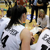 "University of Colorado's Julie Seabrook, right, Meagan Malcolm-Peck, center, Chucky Jeffery and Lexy Kresl, left, listen as Head Coach Linda Lappe goes over a game plan during a time-out while playing Northern Colorado during the first round of the 2012 Women's NIT tournament on Wednesday, March 14, at the Coors Event Center on the CU campus in Boulder. CU won the game 54-40. For more photos and video of the game go to  <a href=""http://www.dailycamera.com"">http://www.dailycamera.com</a><br /> Jeremy Papasso/ Camera"