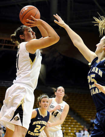 "University of Colorado's Jasmine Sborov takes a shot over Northern Colorado's Molly Duehn during the first round of the 2012 Women's NIT tournament on Wednesday, March 14, at the Coors Event Center on the CU campus in Boulder. CU won the game 54-40. For more photos and video of the game go to  <a href=""http://www.dailycamera.com"">http://www.dailycamera.com</a><br /> Jeremy Papasso/ Camera"