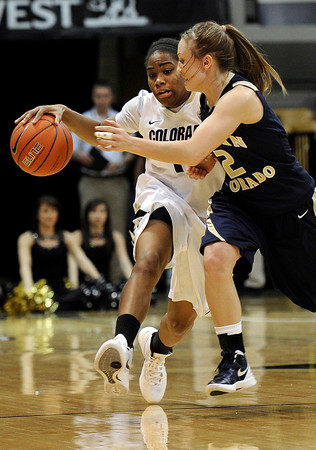 "University of Colorado's Brittany Wilson drives the ball past Northern Colorado's Amy Marin during the first round of the 2012 Women's NIT tournament on Wednesday, March 14, at the Coors Event Center on the CU campus in Boulder. For more photos and video of the game go to  <a href=""http://www.dailycamera.com"">http://www.dailycamera.com</a><br /> Jeremy Papasso/ Camera"